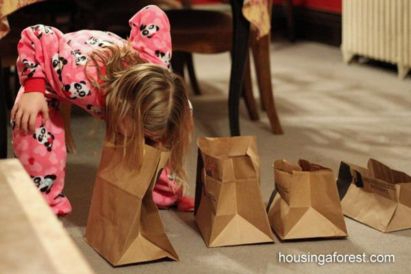 """Bite Me - The challenge was to pick up 5 paper bags cut at varying heights using only our mouths and place them on a table. Make sure that your knees or hands don't touch the floor! That is what makes this game so difficult. """"Minute to Win It"""" Party Games, http://hative.com/minute-to-win-it-party-games/,"""