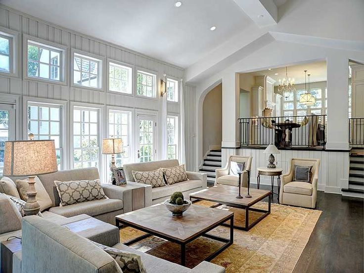Family Room with LOTS of windows and light! (also like the hardwood steps with white fronts)