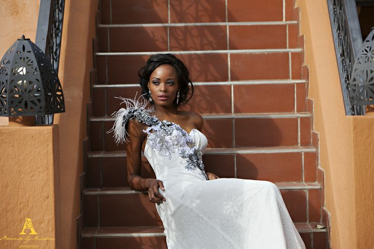Sleek Corseted Wedding Gown with Detailed floating shoulder.