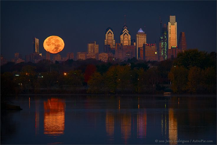 A supermoon sets over the metropolis of Philadelphia in this twilight snapshot captured on November 14 at 6:21am Eastern Standard Time. Within hours of the Moon's exact full phase, that time does correspond to a lunar perigee or the closest point in the Moon's elliptical orbit around our fair planet. Slightly bigger and brighter at perigee, this Full Moon is still flattened and distorted in appearance by refraction in atmospheric layers along the sight-line near the horizon. Also like more…