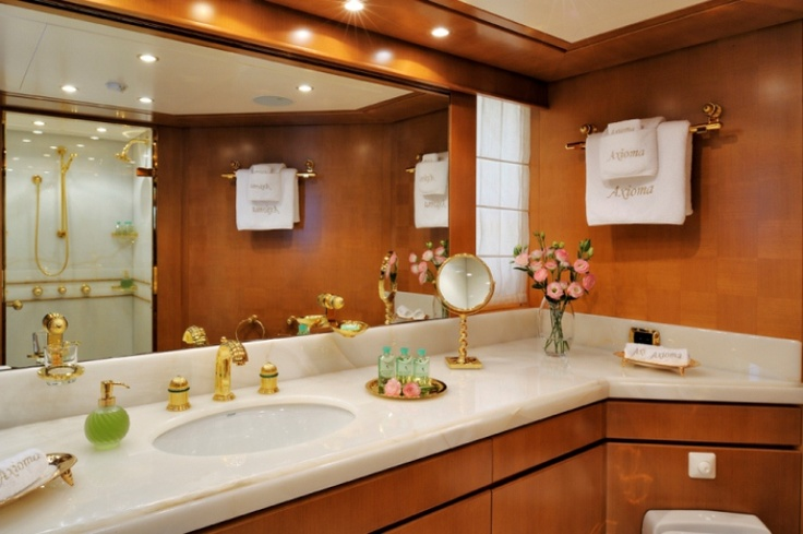 Master Cabin, her bathroom - AXIOMA is a 47,50 m super yacht build by ISA Yachts and can welcome 12 guests in 6 elegant and comfortable rooms. The master cabin is on the main deck and has a study and ensuite his and her's bathroom. On the top deck there is a double cabin with ensuite bathroom and on the lower deck there are two twins and two doubles with ensuite bathrooms. M/Y AXIOMA is for charter through YACHTZOO   #Superyacht for #charter and superyachts for #sale - www.yacht-zoo.com