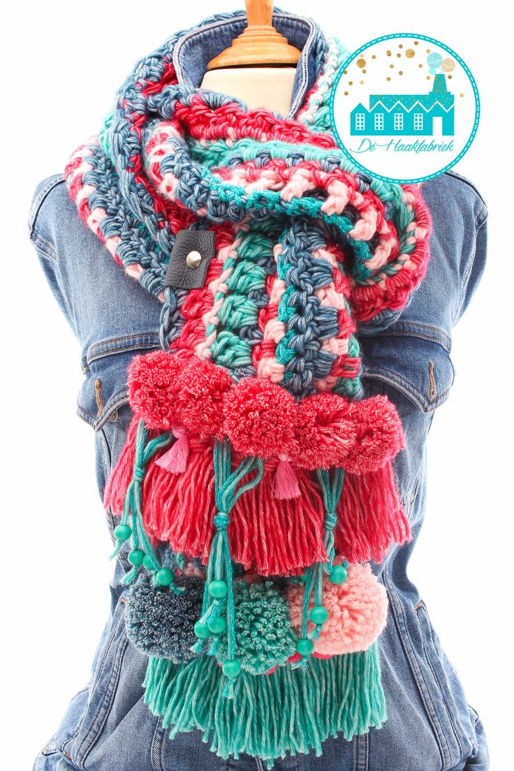 This is crochet but maybe I could knit an awesome scarf like this (and add the pompoms and tassels too, of course!)