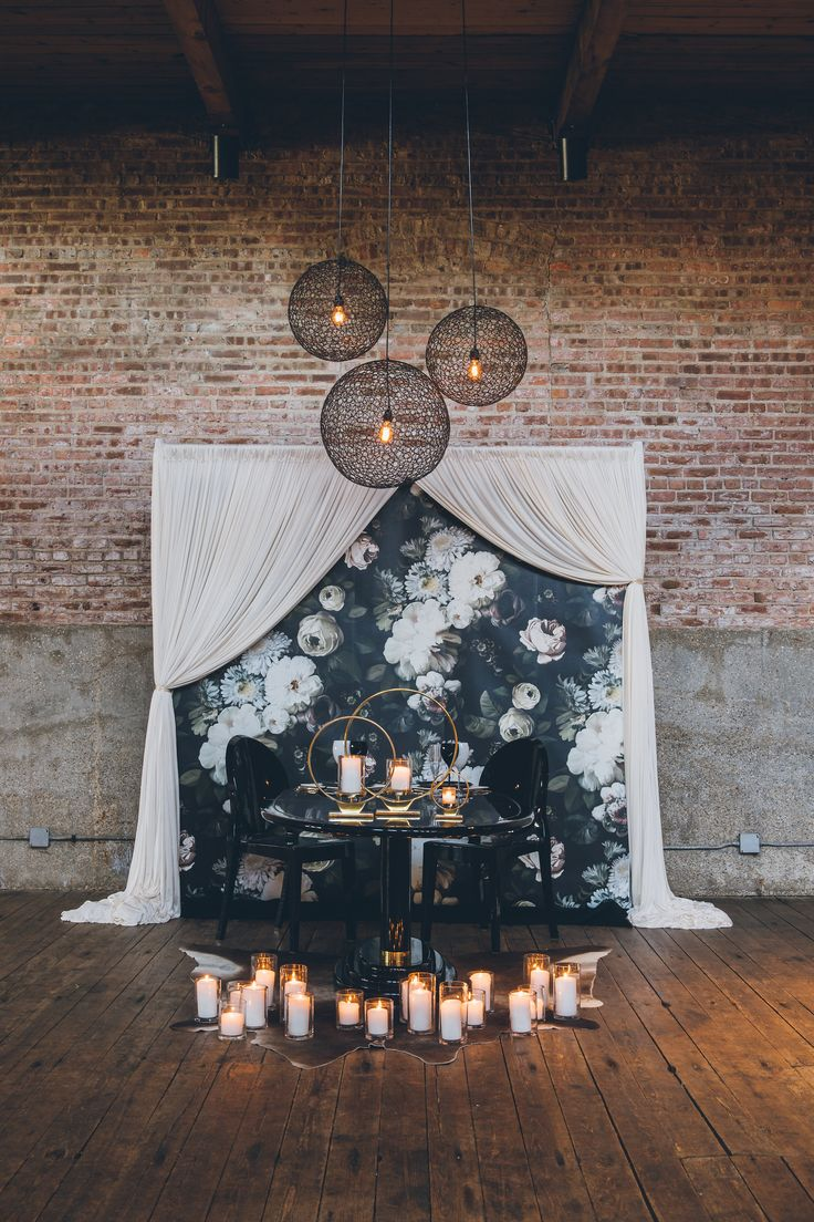 modern romantic wedding decor with black floral wallpaper - photo by Ed and Aileen Photography http://ruffledblog.com/dutch-floral-still-life-wedding-inspiration