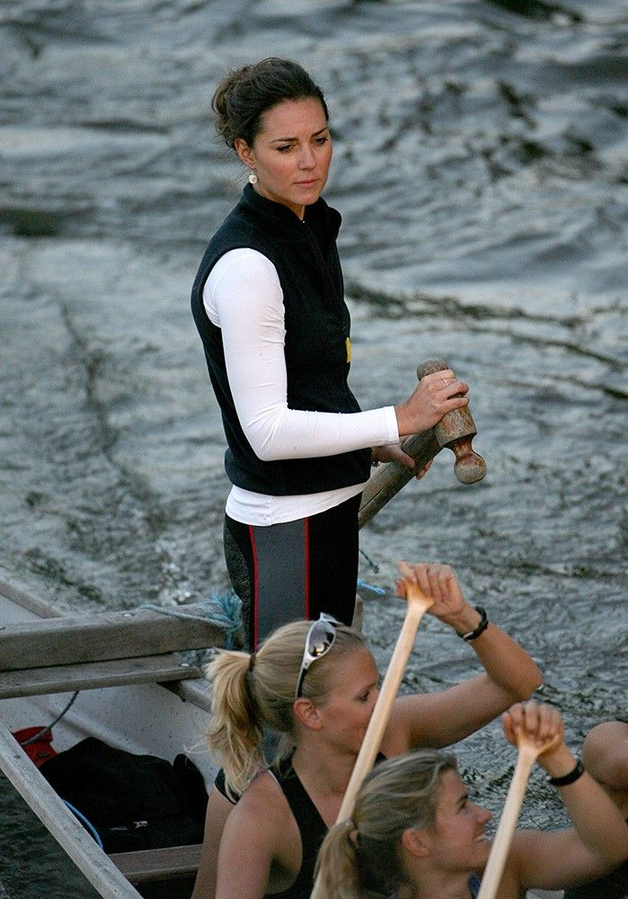 Wearing a vest over long sleeves, Kate and the rowing team practice for the Charity Boat Challenge.