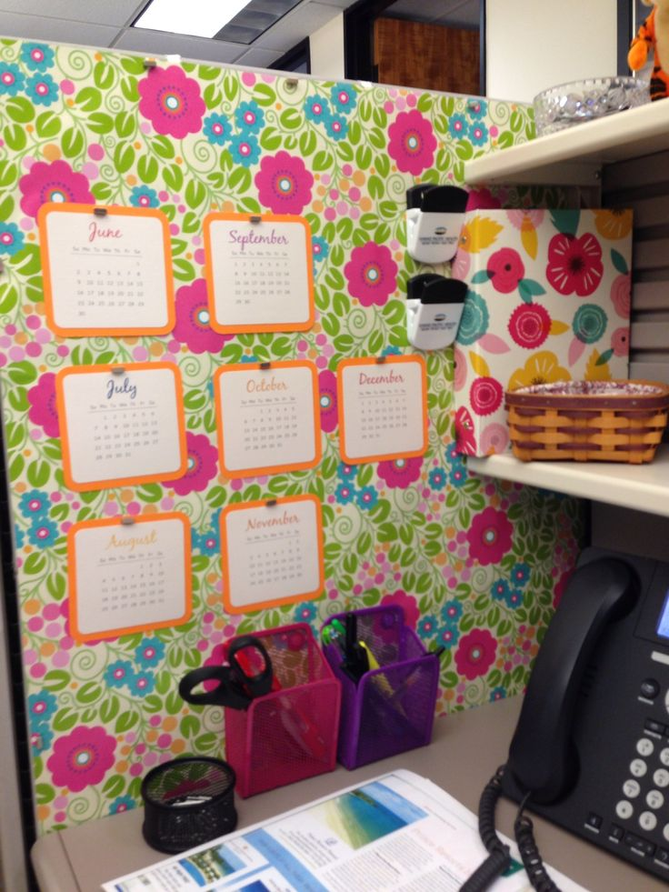 Wrapping paper as wallpaper in a boring gray cubicle.  Magnets hold calendar made with my Silhouette.  I like my #cubicle much better now.  #Cubicle Ideas Cubicle #Decor