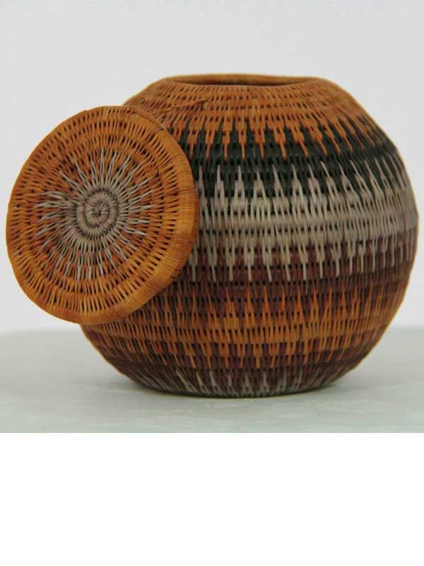 "Covered Namibian Baskets from Shopping for a Change - $112.00 USD -   One-of-a-kind. Hand woven Production took 3-6 months per basket. Plant-dyed local pal, root fibers and natural grasses. Sizes: Small approximately 5""W x 3.5""H, Medium approximately 6.5""W x 5.75""H."