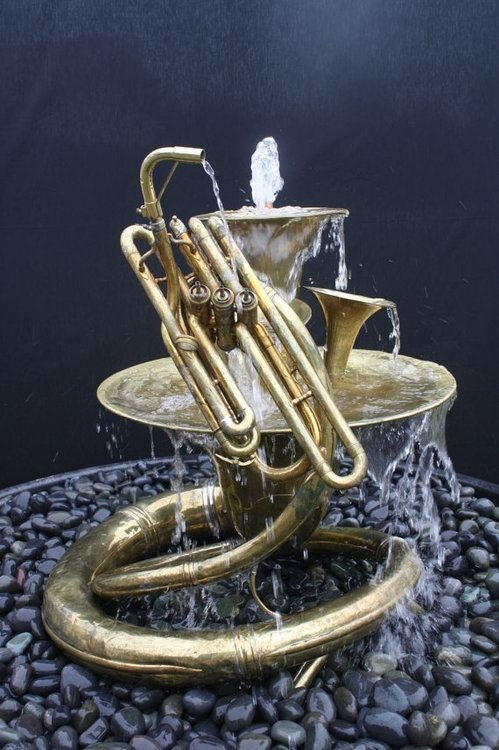 you can believe I'd have a whole ensemble of  water fountains made from instruments in my future garden!