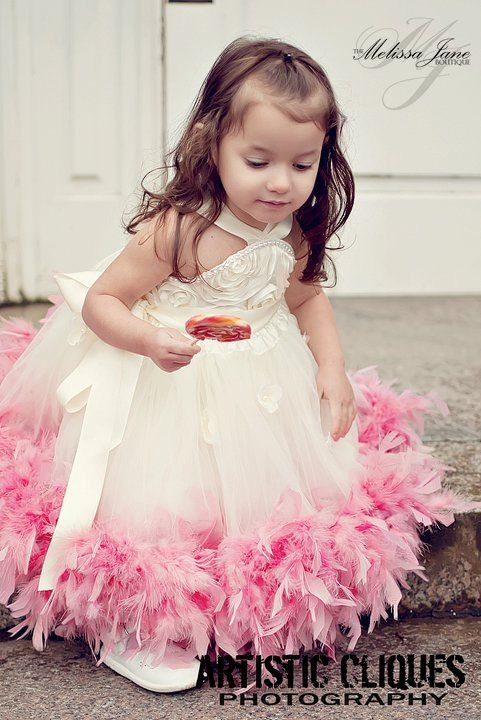 The Flower girl dress: Except the dress with be black instead of white and hot pink feather bottom :)