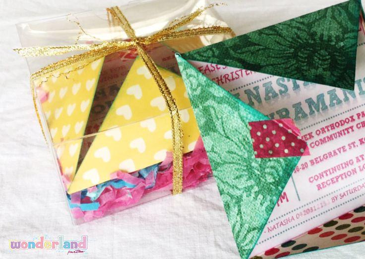 Colourful boxed christening invitations -http://www.wonderlandparties.com.au/
