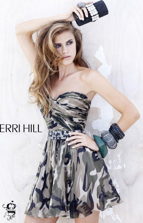 Alright ladies, if not for yourself, impress your man in Sherri Hill 2905!  We assure you not many other girls out there will be wearing anything similar to this!  This short dress has a swing style skirt that's sure to look good on the dance floor.  The bodice is strapless with a sweetheart neckline.  A ruched zig zag pattern cover the bust.  Large rhinestones define the waistline and give this dress a little shine!  The most unique thing about this dress is the print...camo!
