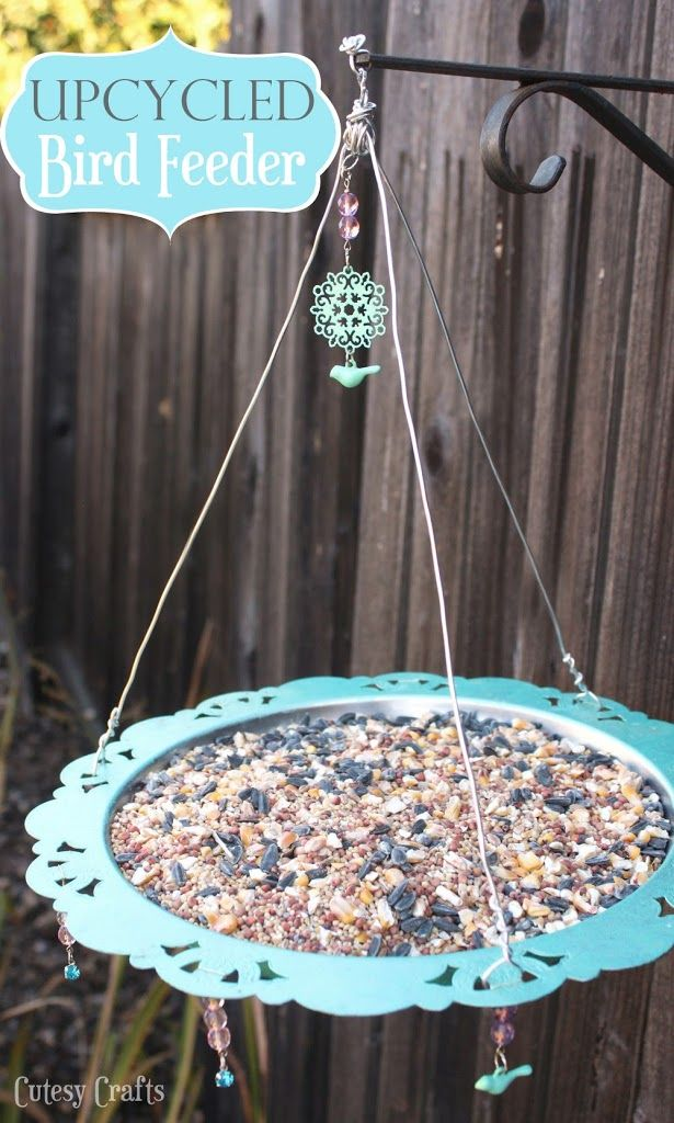 Upcycled bird feeder made from an old silver platter.