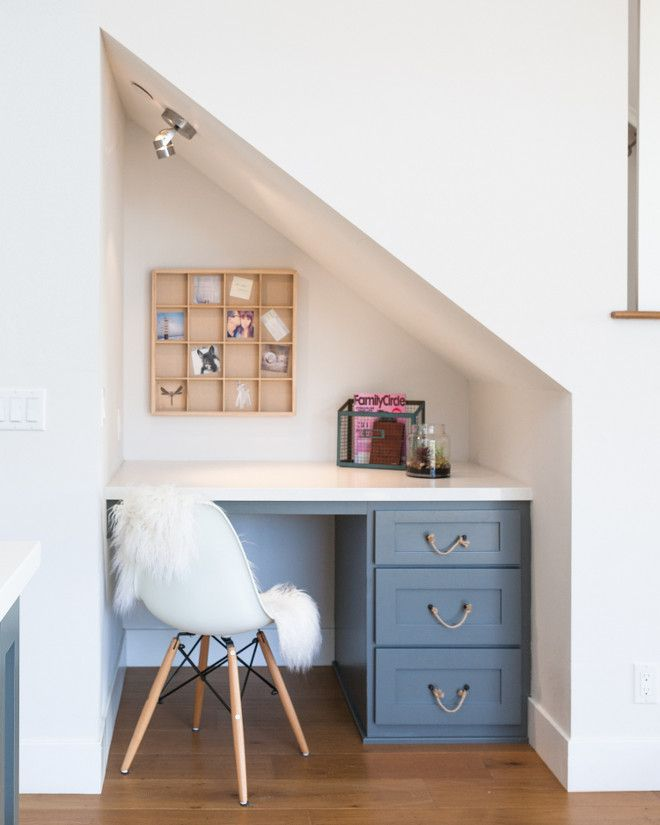 The kitchen features a built-in desk under the stairs. Chair is the World Market White Molded Evie Chairs, Set of 2 – $159.98 – What a find!!! Rope Pulls are by Anthropology.
