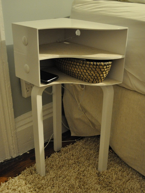 Awesome idea for a mini bedside table DIY made out of magazine racks