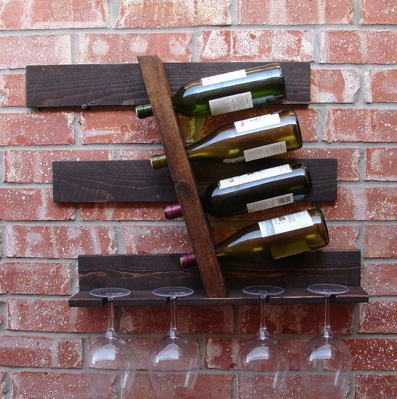Handmade geometric wine rack. Perfect for any home, apartment, or condo loft. It has been sanded down, then stained and sealed with a beautiful dark