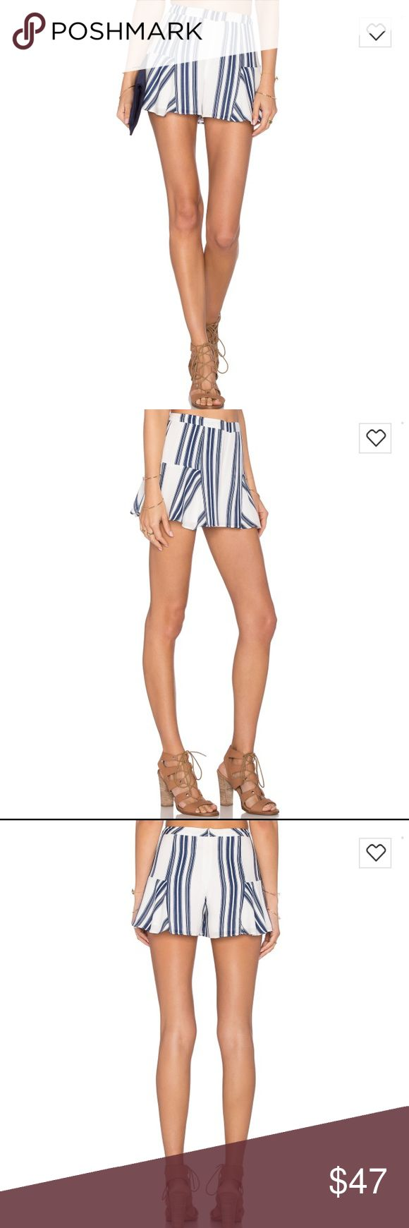 "lovers and friends blue oasis stripe skort lovers and friends blue oasis striped skort. Waist 15"" length 12.5"" ***check out my Instagram @brieharding to see my closet in motion. Everything in my closet has been curated with love and I rock it myself! Lovers + Friends Skirts"