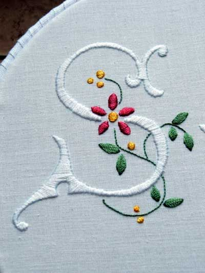 Embroidered monogram S. Need o remember this site for embroidery instructions, ideas and books to order.