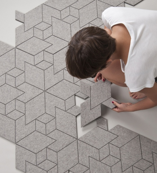 Hello geometric wool felt rug tiles! Inspired by cities, simulating concrete pavement, and designed by Allt Studio.