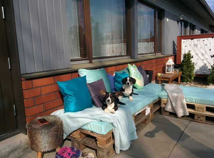 Miina & Manu testing sofa.                                         first really warm day of spring in Finland.   really easy pallet sofa DIY.