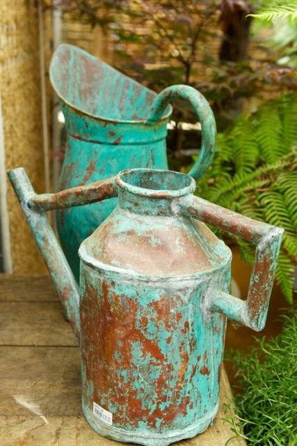 Wonderful patina on this old watering can and pitcher, at Petersham Nurseries in England.
