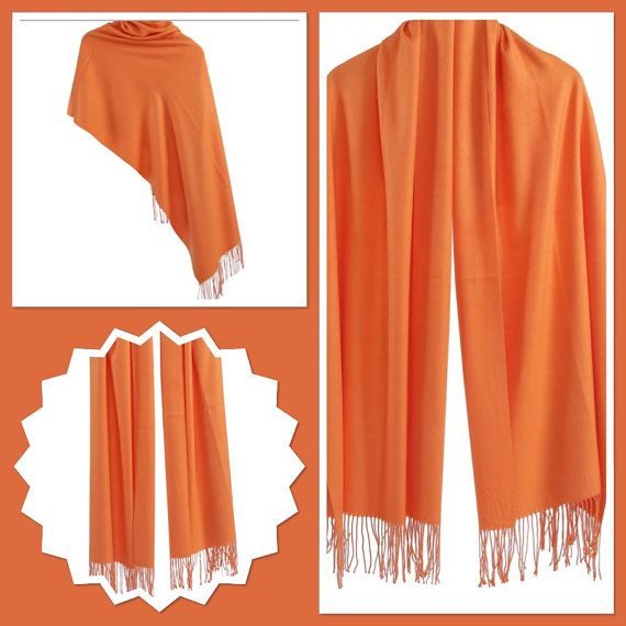 Cozy up this coming season with this luxury Orange Cashmere/Wool/Viscose Blend Pashmina/Wrap/Scarf with delicate Knotted fringe, this material has a luxury Feel to it, and is a Mediumweight weight, perfect for Cooler days. 20% Cashmere/10% Wool/70% Viscose Blend DryClean Only