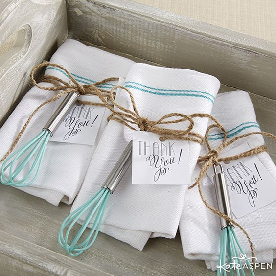 Bundle cute whisks with tea towels for an awesome favor for a kitchen themed bridal shower! | kateaspen.com