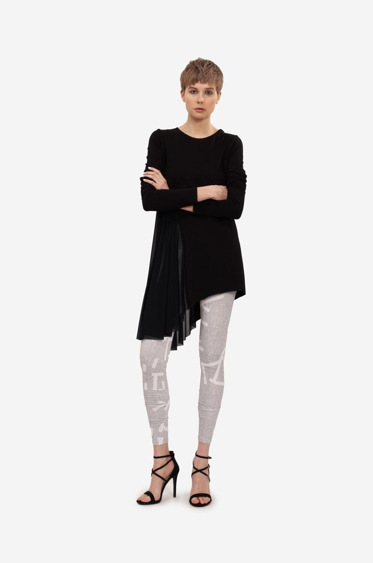 """MINI DRESS """"SIDE WIND"""" Shorthaired model wearing an asymetric jersey top or little dress with long sleeves and semitransparent prolonged part on side. Elastic overall with original print underneath."""