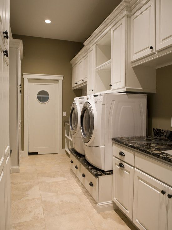 Love the raised washer/dryer on the built in cabinet with drawers.