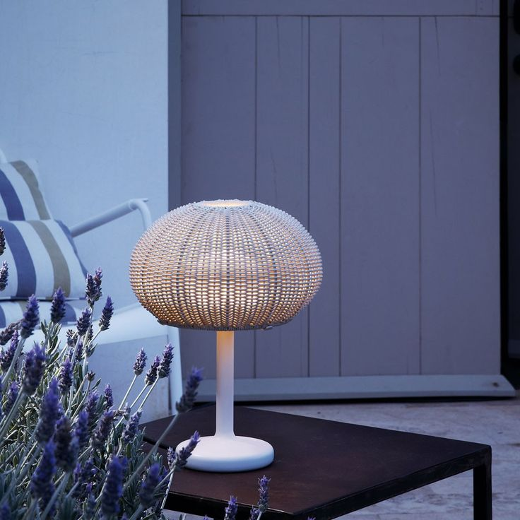 Finish off your outdoor seating area with a Garota Outdoor Table Lamp. http://www.ylighting.com/blog/modern-outdoor-lighting-from-bover/