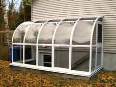 walk up basement awning - is glass a good idea with the boys playing in the backyard