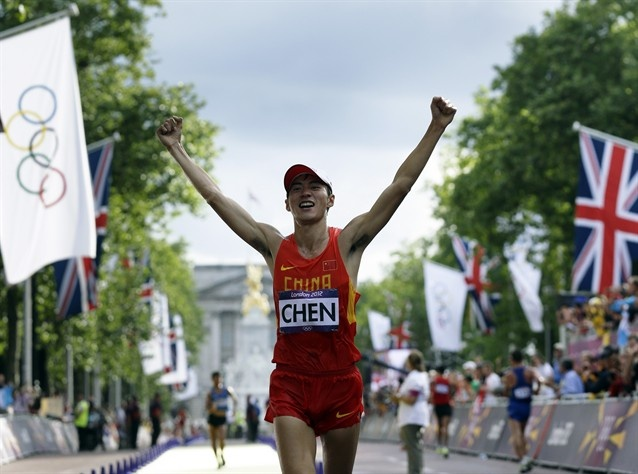 China's Chen Ding celebrates as he crosses the finish line to win the men's 20-kilometer race walk at the 2012 Summer Olympics.