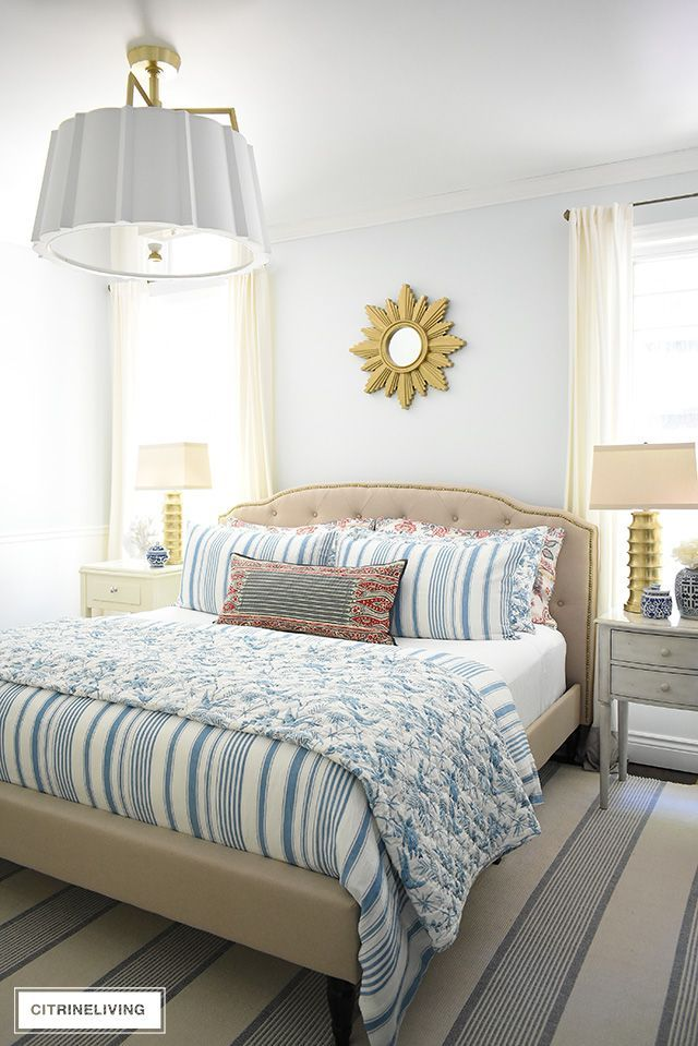 Beautiful summer decorated bedroom with blue and white striped