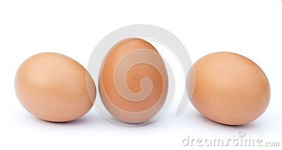 Three brown chicken eggs in a row isolated against a white background.