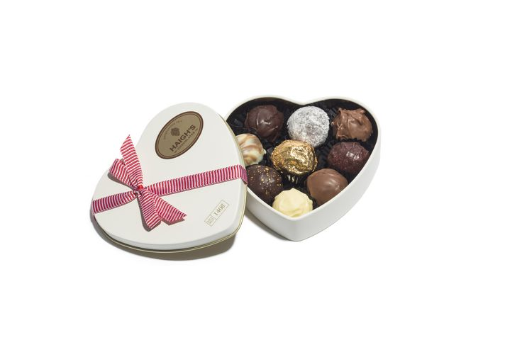 """A selection of Haigh's truffles in a beautiful heart shaped tin. The perfect way to say """"I love you"""" this Valentine's Day."""