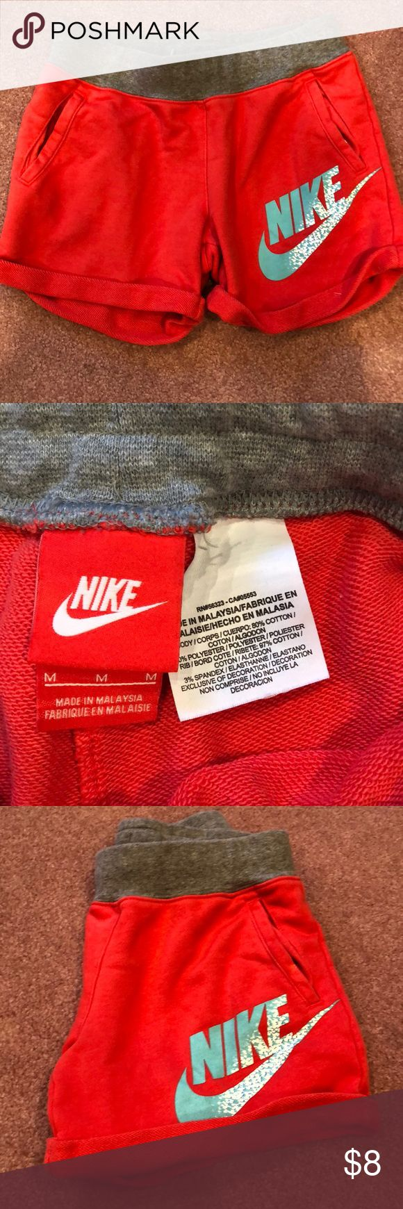 Girls M Nike cotton shorts Girls Medium size (not women's!) red cotton shorts with pockets. Gently worn, in good condition. Nike Shorts