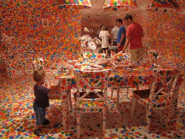 Obliteration Room at the Gallery of Modern Art in Brisbane.  Guests are encouraged to take sticker dots and place them wherever they like!