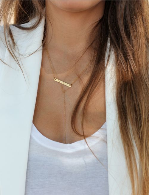 white tee + gold bar necklace.