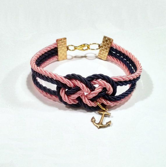 Navy blue and light pink double infinity knotted nautical rope bracelet with gold anchor charm