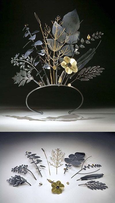 "Jan Yager's ""Tiara of Useful Knowledge. City Flora: The Philadelphia Series (2006)"" and is made of oxidized sterling silver, 18K and 14K gold.  Each piece of the tiara transforms, coming off to become a separate entity --- brooch, tie tac, pendants...  and each represents a specific plant as well: (Left to Right, Back to Front) Common Ragweed, Sweet Clover, Lamb's Quarters, Plantain, Switch Grass, Potato, Rye, Prickly Lettuce, Crab Grass, Ant, Tobacco, Pebble."