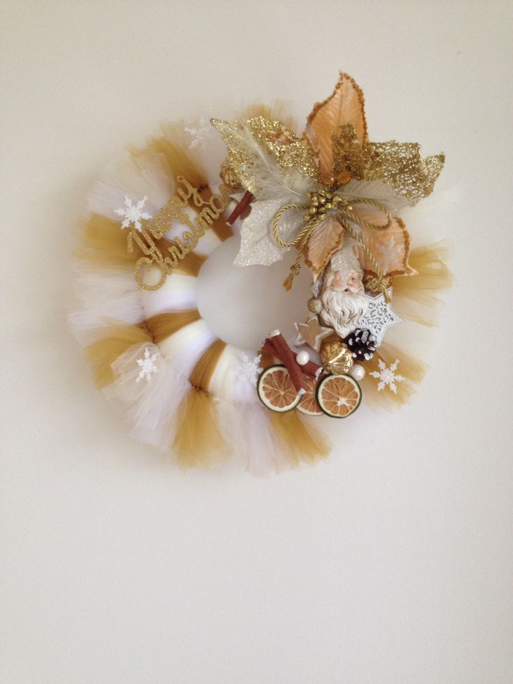 Tulle Christmas wreath. Gold-white.  Added Santa's head, poinsettia flower, dry lemons, cinnamon sticks, christmas balls. Christmas sign and snowflakes.  More at https://www.facebook.com/Moje-vence-995508700482994/