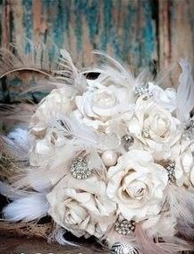 Bouquet created with sustainable feathers, hand sculpted and painted paper roses in ivory tones.