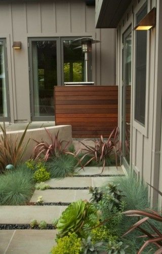hide the trashcans: Create a solid screen. It would be easy to tuck recycling bins or a compost pail behind this compact design — which looks like an architectural element of the home. It's not high enough to mask a standard wheeled trash can, but a smaller one would fit nicely.