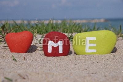 I love me conceptual image with colourful stones on the sand