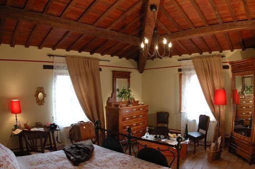 Camera con angolo soggiorno