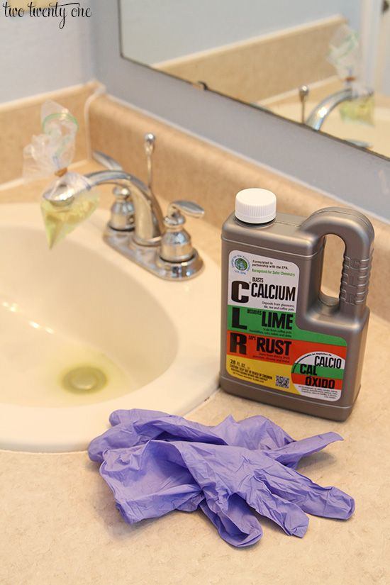How to remove calcium build up: Fill a plastic bag with 1 part CLR, 1 part water. Secure it on the faucet spout with a rubber band & leave it for a few hours. Wear gloves & use a Magic Eraser (generic is fine) and rub off the build up. You could probably get by with using a rag. Read the CLR bottle to make sure it's compatible with your faucet material AND spot test the CLR on your faucet before beginning.