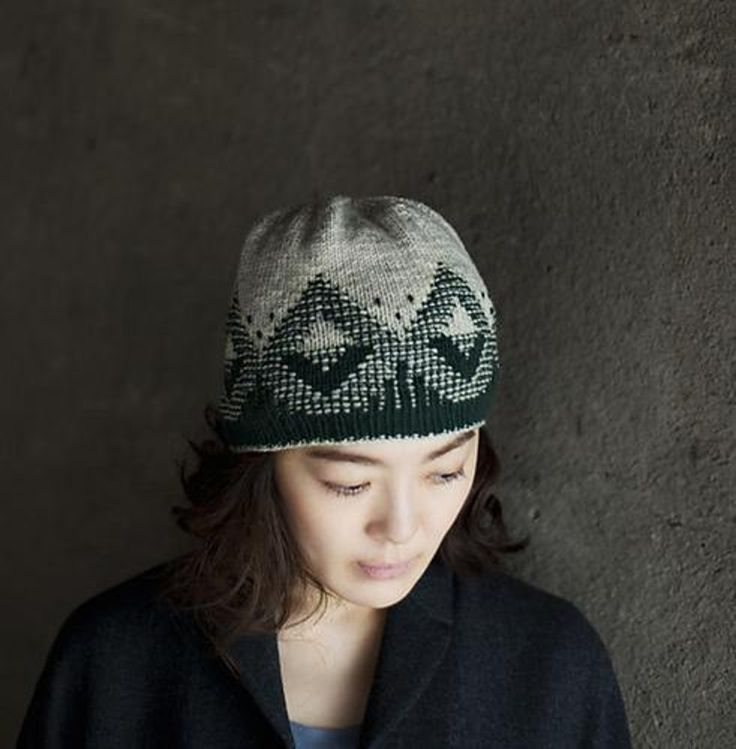 """'Phōs' is pronounced as 'foce', which means the Greek work for light. The name was chosen, because Fiona was inspired by the way light filtering through the layers of leaves in designing the geometric diamond shapes. Instead of traditional stranded knitting and using only the knit stitch, this pattern plays with combining knits, purls and slipped stitches to form this geometric pattern. Using Quince & Co. Chickadee, it is ideal for """"regaining rhythm"""" in your knitting at the beginning of f..."""
