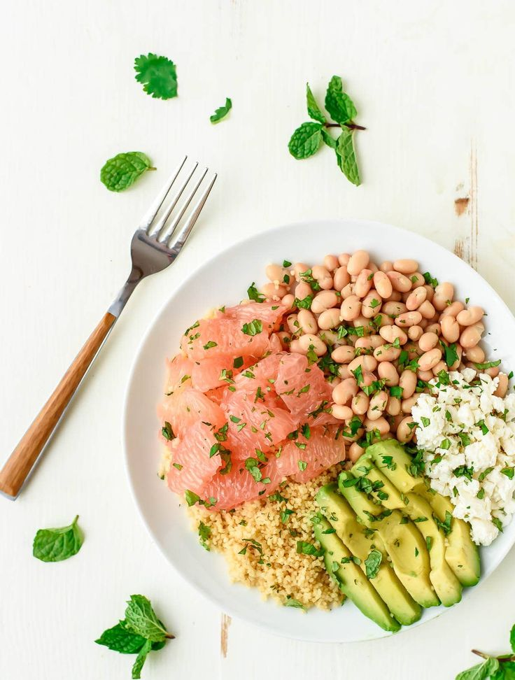 A light and bright grapefruit salad with avocado, couscous, white beans, and feta. Easy to make and perfect for a healthy lunch or side.