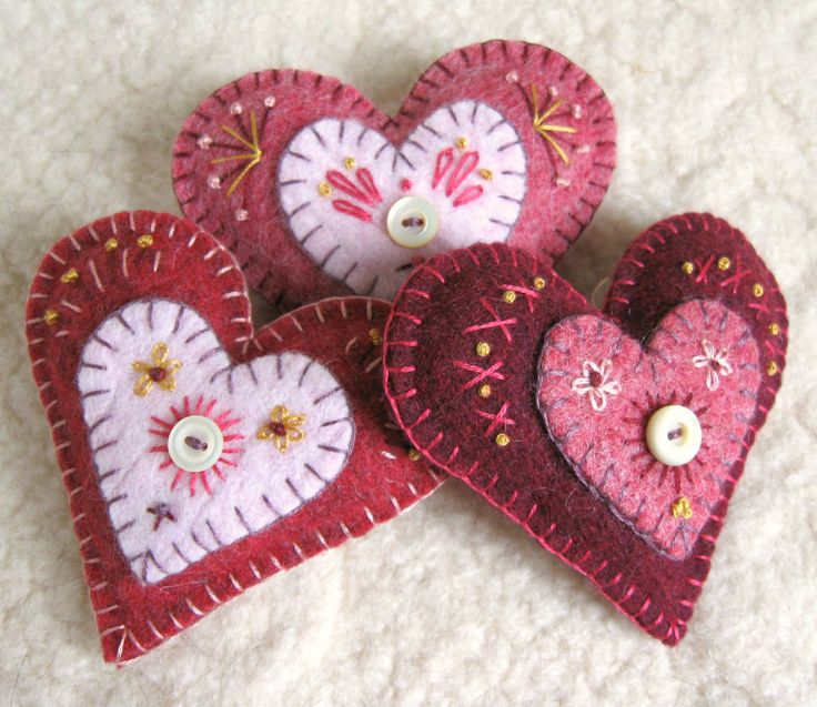felt hearts | First I used a blanket stitch to add a small contrasting heart shape ...