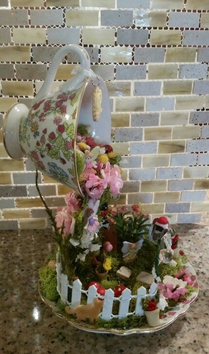 Floating teacup fairy garden