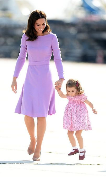 Duchess Cambridge couldn't help but smile when daughter Princess Charlotte took a leap as the Cambridges prepared to head home from their five-day tour of Germany and Poland. Photo: Getty Images