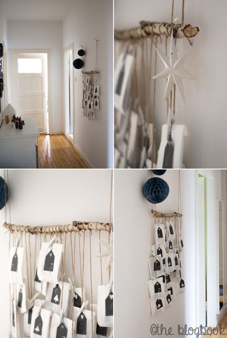 Cool and stylish advent calender made of small paper bags which are hung on a birch branch interior living home blackandwhite